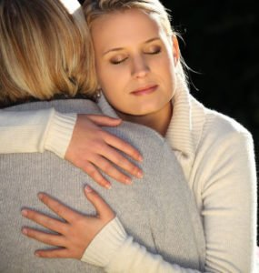 11132370 – a mother and her teenage daughter hugging.